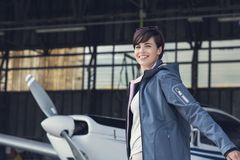 Cheerful pilot posing with a small aircraft Stock Photo