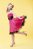 Cheerful pin-up girl is flirting with you Royalty Free Stock Photo