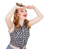 Cheerful pin -up girl looking afar. Photo of cheerful pin -up girl looking afar Stock Photo