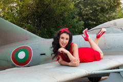 Cheerful pin-up model on airplane wing Royalty Free Stock Photography