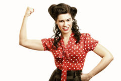 Cheerful pin up woman flexing biceps isolated royalty free stock photography