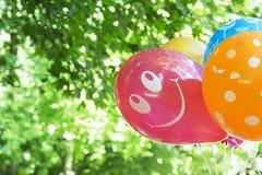 Cheerful pink balloon Stock Image