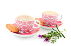 Cheerful pink cups and saucers Stock Images