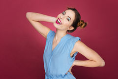 Cheerful playful young woman smiling and posing Royalty Free Stock Images