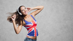 Cheerful pop girl dancing Royalty Free Stock Images