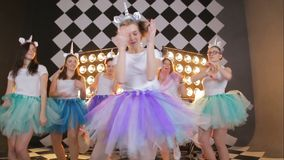 Happy crazy holidays group portrait of a young dancing girls in a fairy unicorn costume and colorful tutu skirts on hen. Cheerful portrait of a young bride stock video footage