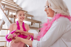 Cheerful positive girl having fun with her grandmother Stock Photos