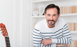 Cheerful positive man looking at you Royalty Free Stock Photo