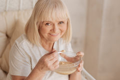 Cheerful positive woman enjoying her breakfast Royalty Free Stock Images