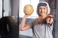 Cheerful positive woman enjoying her workout Royalty Free Stock Photo