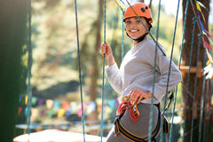 Cheerful positive woman having a great time in adventure park Royalty Free Stock Photo