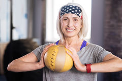 Cheerful positive woman holding a ball Royalty Free Stock Photos