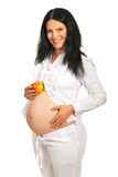 Cheerful pregnant with apple on belly Royalty Free Stock Photo