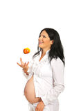 Cheerful pregnant throwing apple Royalty Free Stock Photo