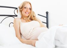 Cheerful pregnant woman  in bed Royalty Free Stock Photos