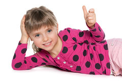 Cheerful preschool girl resting Royalty Free Stock Photos