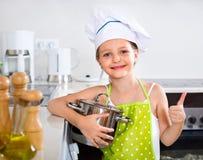 Cheerful preschooler posing with pan Stock Images