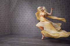 Cheerful, pretty blonde dancing and smiling Royalty Free Stock Photo