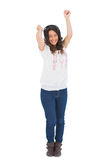 Cheerful pretty brunette dancing while listening to music Royalty Free Stock Photos