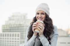 Cheerful pretty brunette having coffee Royalty Free Stock Photography