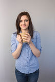 Cheerful pretty brunette holding cup of coffee Stock Photo