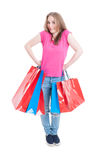 Cheerful pretty customer holding bags and acting funny on shoppi Royalty Free Stock Photography