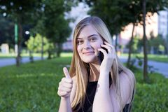 Cheerful pretty girl enjoying nature royalty free stock images