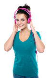 Cheerful pretty girl listening to music Stock Image