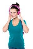 Cheerful pretty girl listening to music Stock Image