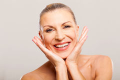 Mid age woman makeover. Cheerful pretty mid age woman after makeover stock photography