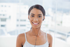 Cheerful pretty model listening to music Royalty Free Stock Photos