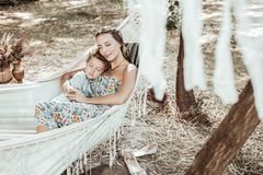 Cheerful pretty mother and child sleeping together