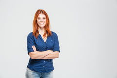 Cheerful pretty redhead young woman standing with hands folded Royalty Free Stock Image