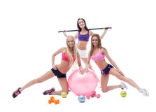 Cheerful pretty sportswomen posing in studio Royalty Free Stock Image