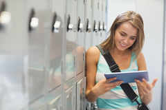 Cheerful pretty student using tablet Stock Photos