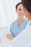 Cheerful pretty surgeon talking with a doctor Royalty Free Stock Photography
