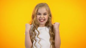 Cheerful pretty teenage girl making yes gesture, successful promo campaign, win stock footage