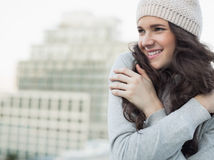 Cheerful pretty young brunette shivering Stock Image