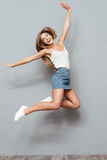 Cheerful pretty young girl jumping Stock Photos