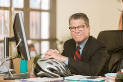 Cheerful Professional Man with Bicycle Helmet stock image