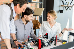 Cheerful professional team discussing in office Stock Images