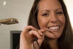 Cheerful Professional Woman Holding Eyeglasses. Closeup portrait of smiling professional woman holding eyeglasses Stock Photo