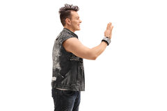 Cheerful punk rocker waving to someone. With his hand isolated on white background Stock Photo