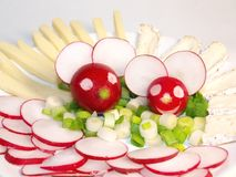 Cheerful radish mice. Cheerful mice figures made of radish, arranged on a plate Stock Photography