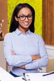 Cheerful receptionist. Royalty Free Stock Photography