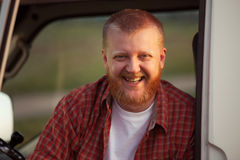 Cheerful red-bearded man in a plaid shirt Stock Images