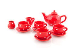 Cheerful red crockery. Cheerful speckles red crockery isolated over white Royalty Free Stock Photography