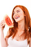 Cheerful red hair young woman holding watermelon Stock Photo
