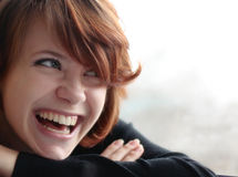 Cheerful red-haired girl Royalty Free Stock Photos