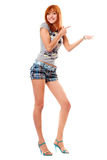 Cheerful red-haired girl in a t-shirt and shorts Royalty Free Stock Image